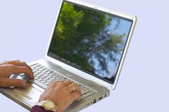 Outdoor Office. Businessman using laptop. Screen image easily removed if required Stock Images