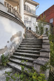 Outdoor old style spiral stairs in old mansion Stock Images