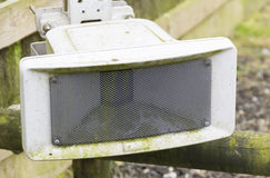 Outdoor PA speaker attached to fence Royalty Free Stock Images