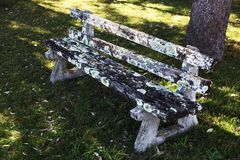 Old park bench with deteriorating wood Stock Images