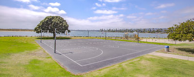 Outdoor park with black top and two basketball courts on the bay of San Diego California. Outdoors in Southern California homes ready for real estate listings Stock Photo
