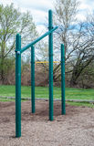 Outdoor park exercise equipment. Sports exercise in park. Pull-up bars, angled climbing. Staying healthy outdoors. Steel bar frames stock images
