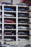 Outdoor Parking Garage. Vertical stacks of cars in an outdoor parking garage in NYC Stock Image