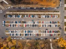 Outdoor parking lot or car park with rows of autos in urban landscape, aerial or top view. Toned royalty free stock image