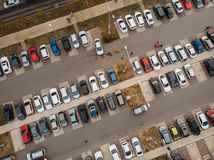 Outdoor parking lot or car park with rows of autos in urban landscape, aerial or top view. Toned stock images