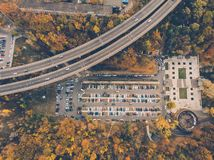 Outdoor parking lot or car park with rows of autos in urban landscape, aerial or top view. Toned stock photos