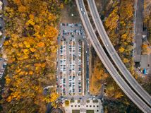Outdoor parking lot or car park with rows of autos in urban landscape, aerial or top view. Toned royalty free stock photo