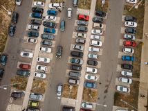 Outdoor parking lot or car park with rows of autos in urban landscape, aerial or top view. Toned royalty free stock photos