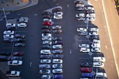Outdoor parking lot full of cars stock photos