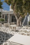 Outdoor part of a Greek taverna on the street royalty free stock photography