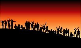Outdoor party. Silhouettes of people partying outdoors in the evening Stock Photo