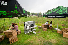 Outdoor party with music on green area of city Royalty Free Stock Photo