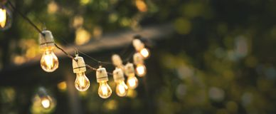 Free Outdoor Party String Lights Hanging In Backyard On Green Bokeh Background Stock Photography - 157481302