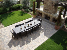 Outdoor Patio and Fireplace. Beautiful outdoor patio with a fireplace and a table and chairs Stock Images