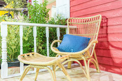 Outdoor patio seating area in house with nice rattan table Royalty Free Stock Photos