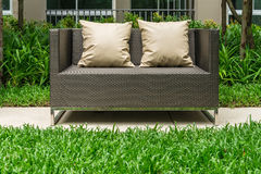 Outdoor patio seating area. With Rattan sofa royalty free stock images