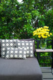 Outdoor patio seating with daybed Stock Photos