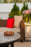 Outdoor patio seating are with nice Rattan sofa Royalty Free Stock Image