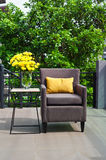 Outdoor patio seating are with nice Rattan sofa at sunset Royalty Free Stock Images