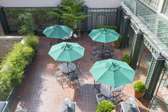 Outdoor Patio Seatings with Umbrellas Stock Photo
