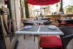 Outdoor patio table setting Royalty Free Stock Images