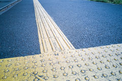 Outdoor pedestrian tactile facility for visually impaired people Royalty Free Stock Images