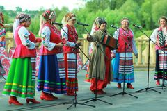 Outdoor performance of women singers wearing ukrainian ethnic traditional clothes and celebrating pagan holiday of Ivan Kupala
