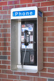 Outdoor phone on brick. Outdoor public phone located in mall complex Stock Images