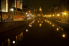 Amsterdam in the bright lights of the night city Stock Image