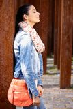 Outdoor photo of pretty woman side view Royalty Free Stock Photography