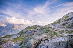 Outdoor Photographer Standing on the Edge of Mountain in front o stock images
