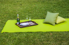 Outdoor picnic with outdoor fabric and pillows Stock Image