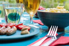 Outdoor picnic table with food Stock Image