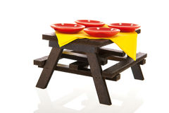 Outdoor picnic table. With plates isolated over white background Royalty Free Stock Photography