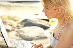 Outdoor picture of blond with laptop Royalty Free Stock Images
