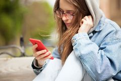 Young lovely woman with smartphone royalty free stock photos