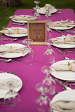 Outdoor Place Setting for Kids` Table. Pink tablecloth and cute framed sign royalty free stock photos