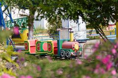 Outdoor play center for children with train and railway attrations. Entertainment concept