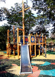 Outdoor playground. A playground is an outdoor area set aside for recreation and play, especially one containing equipment such as slides and nets Stock Photos