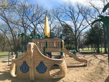 Outdoor playground with children playing wintertime in North Texas, America. Kids running at colorful playground during wintertime in Lewisville, Texas, USA royalty free stock photography