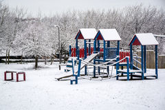 Outdoor playground covered by snow in UK winter 2 Stock Photo