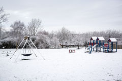 Outdoor playground covered by snow in UK winter 1 Stock Image