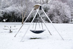 Outdoor playground covered by snow in UK winter 3 Stock Image