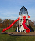 Outdoor playground equipment. Scenic view of colorful play equipment on outdoor playground Royalty Free Stock Photos