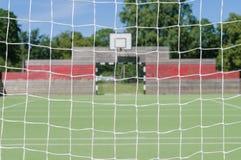 Outdoor playground through soccer goal net. Blurred background of outdoor playground through soccer goal net Stock Image