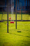 Outdoor playground with swing on green grass Stock Photo