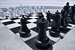 Outdoor playing Chess. With big Figures Royalty Free Stock Photo