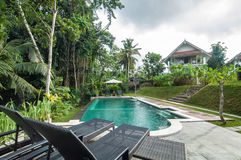 Outdoor pool area of Luxury Bali villa Royalty Free Stock Photos