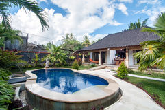 Outdoor pool area of Luxury Bali villa Royalty Free Stock Photo
