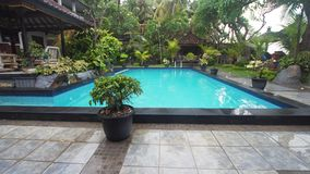 Outdoor pool in the hotel. Luxurious open air swimming pool at resort. Swimming pool with turquoise water in a luxury hotel. Travel concept Royalty Free Stock Photo